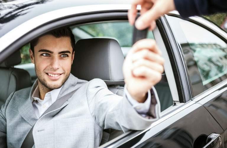 Man Getting Handed Keys to Used Vehicle