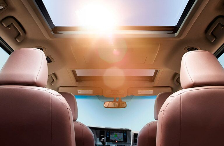 View of Moon Roof and Rear Seating in Tan in the 2017 Toyota Sienna