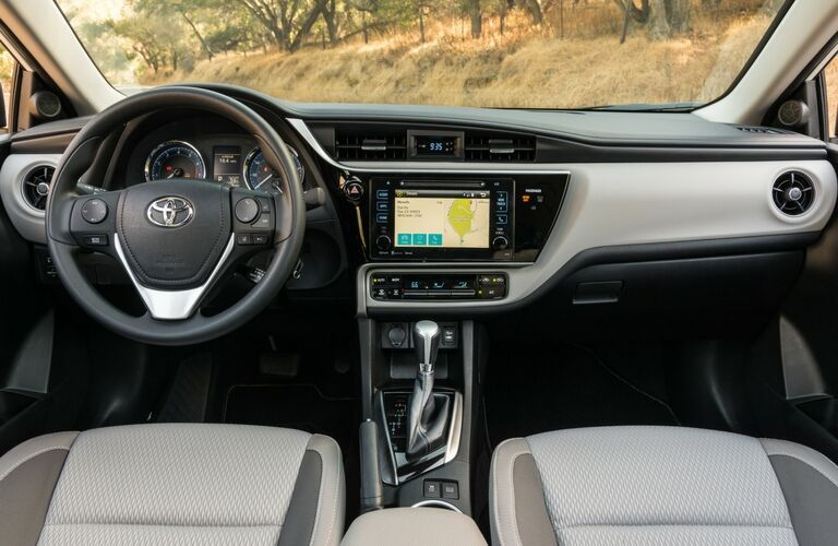 2017 Toyota Corolla Interior View of Dashboard and Steering Wheel in Black and Gray