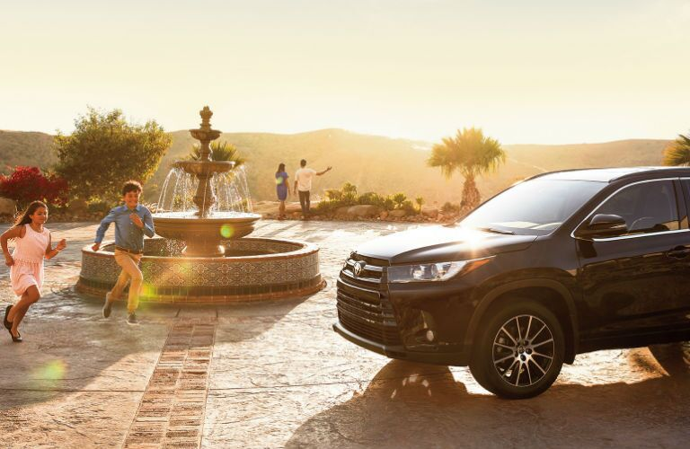Kids Playing by a 2017 Toyota Highlander in Black