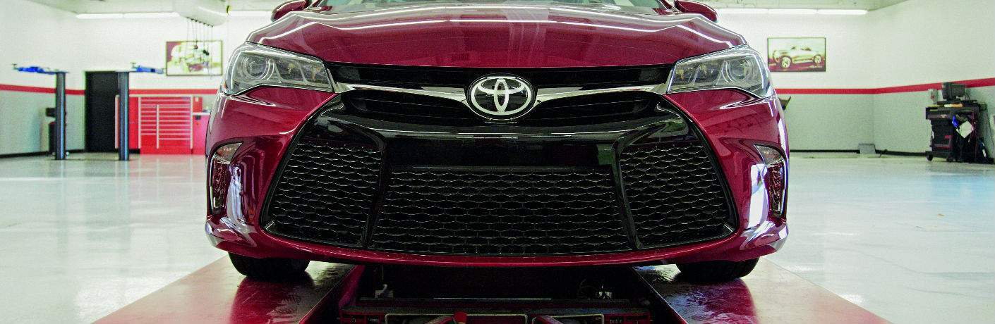 Toyota Camry Close up of Black Grille on Red Exterior
