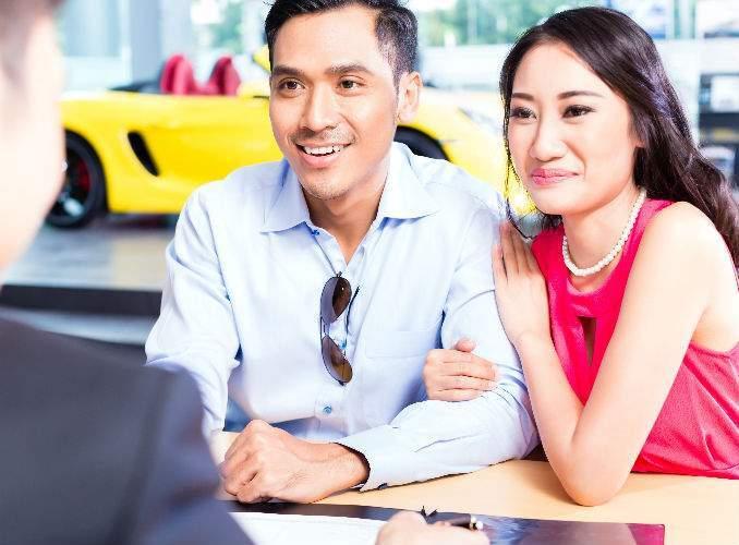Happy Couple Buying Used Car