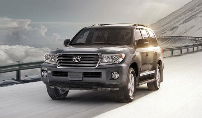 Toyota Land Cruiser in Gray Driving Down Mountain Road