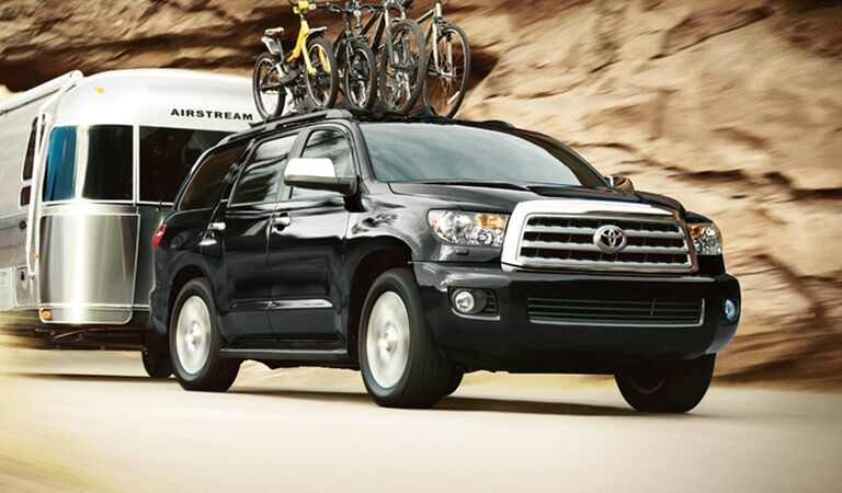 Toyota Sequoia Towing Camper with Bikes on Bike Rack
