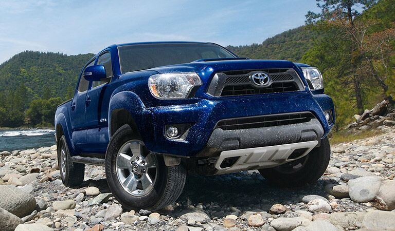 Toyota Tacoma Driving Over Rocks in Blue