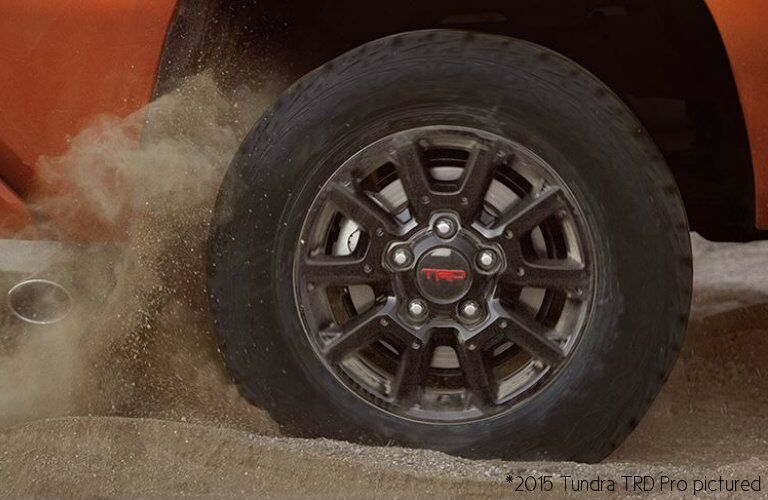 2017 Toyota Tundra close up on wheel in sand_o