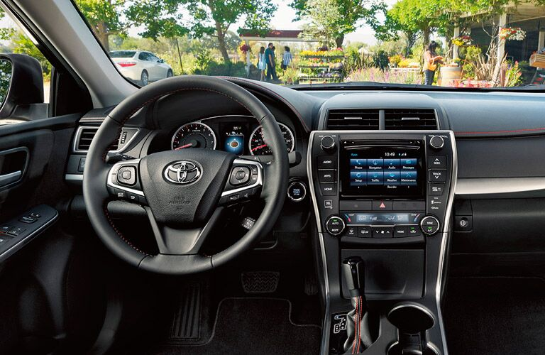 Interior View of the 2017 Toyota Camry in Black Steering Wheel and Center Dashboard