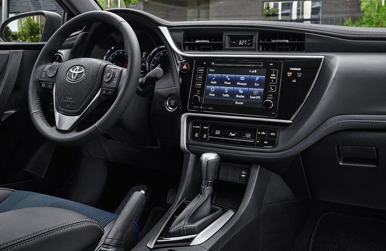 2018 Toyota Corolla Interior View of Dashboard and Steering Wheel in Black