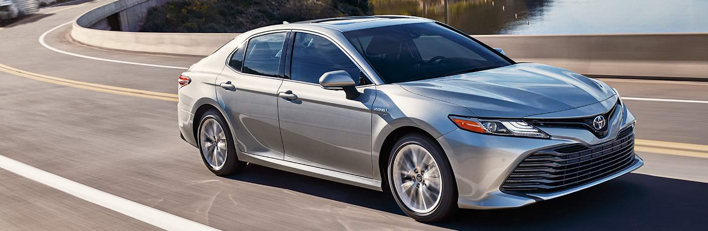 2018 Toyota Camry Driving Down Road in Silver Exterior