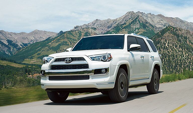 Toyota 4Runner Exterior View of Front End and Side in White Driving Through Mountains