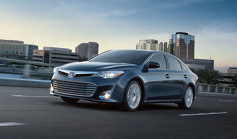 Toyota Avalon Driving Through City Front End and Side View in Navy