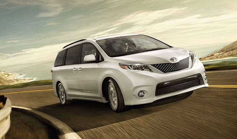 Toyota Sienna in White Front End and Side View