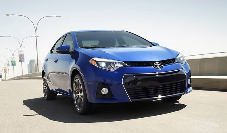 Toyota Corolla Driving Down Highway Exterior View in Blue