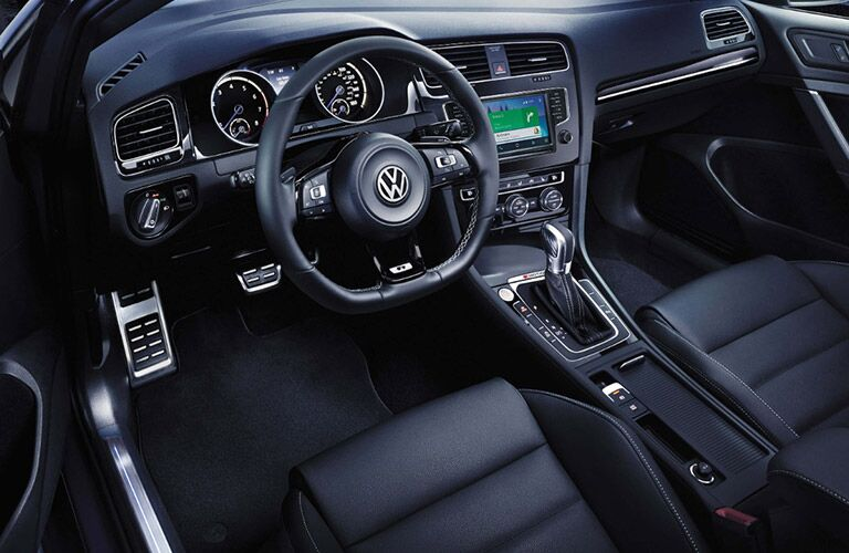 View of the 2017 Volkswagen Golf R's interior from the driver's side