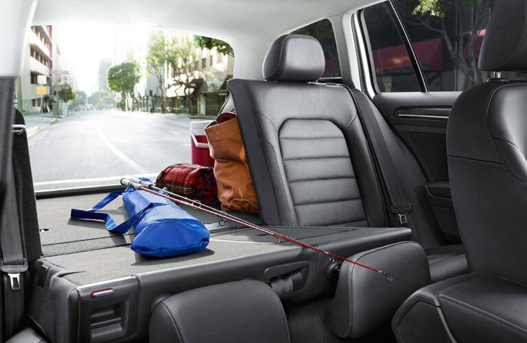 View of the 2017 Volkswagen Golf SportWagen's cargo space, with seats folded, from the passenger seat