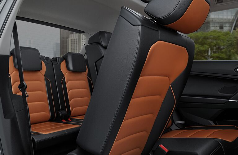Passenger view of the second and third row seats in the 2019 Volkswagen Tiguan with a second row seat tilted forward