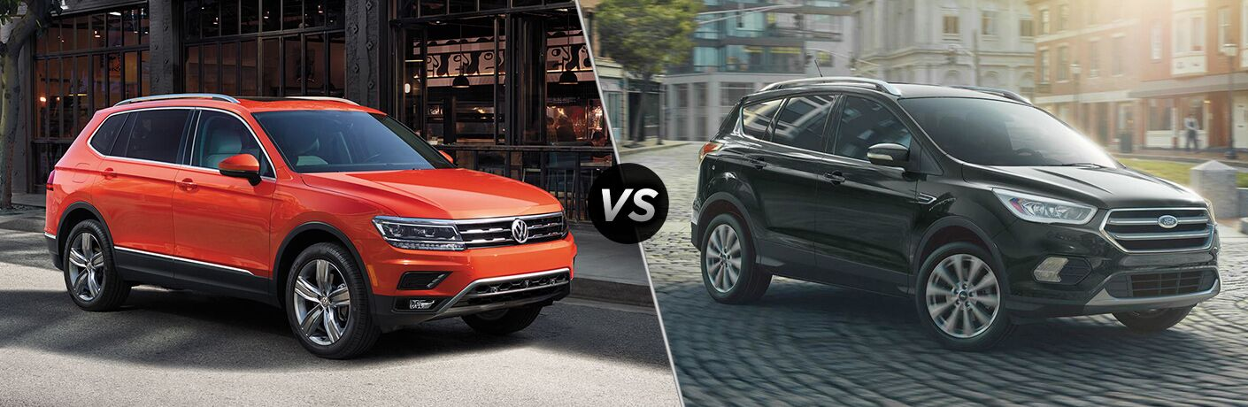 Front passenger view of an orange 2019 Volkswagen Tiguan on left VS front passenger angle of a black 2019 Ford Escape on right