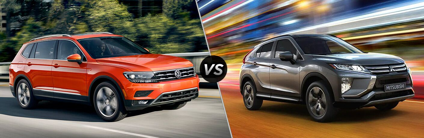 Front passenger angle of an orange 2019 Volkswagen Tiguan on left VS front passenger angle of a grey 2019 Mitsubishi Eclipse Cross on right
