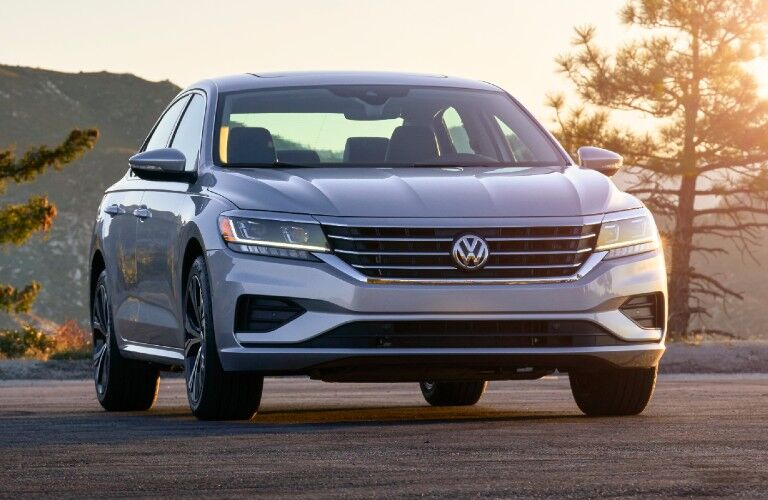 The front of a gray 2020 Volkswagen Passat during a sunset.