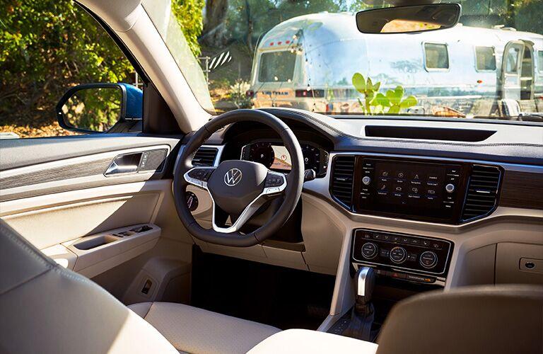 2021 Volkswagen Atlas interior shot of steering wheel, transmission, and dashboard screen