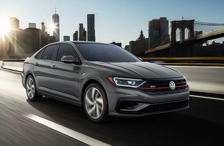 2021 Volkswagen Jetta GLI driving on a road