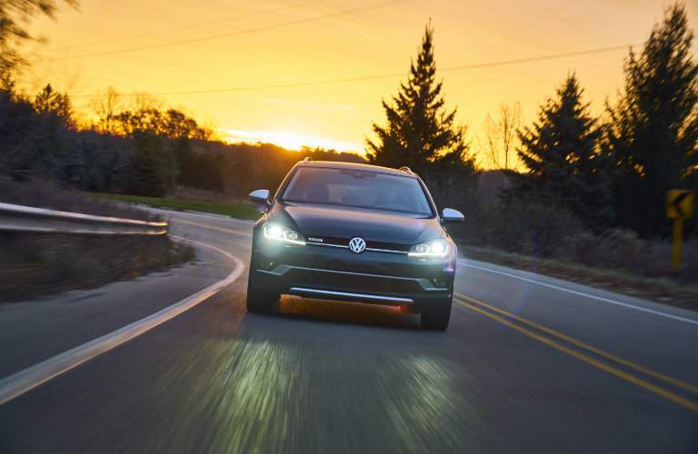 2018 Volkswagen Golf Alltrack driving at sunset