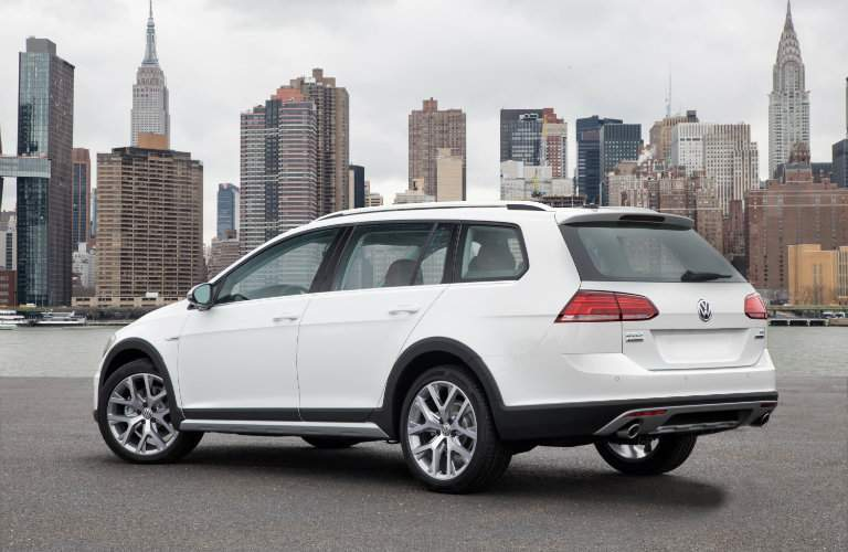 2018 Volkswagen Golf Alltrack white parked in front of cityscape