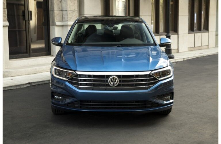 2019 Volkswagen Jetta exterior front shot of grille, headlights, bumper, and fascia parked in front of marble building