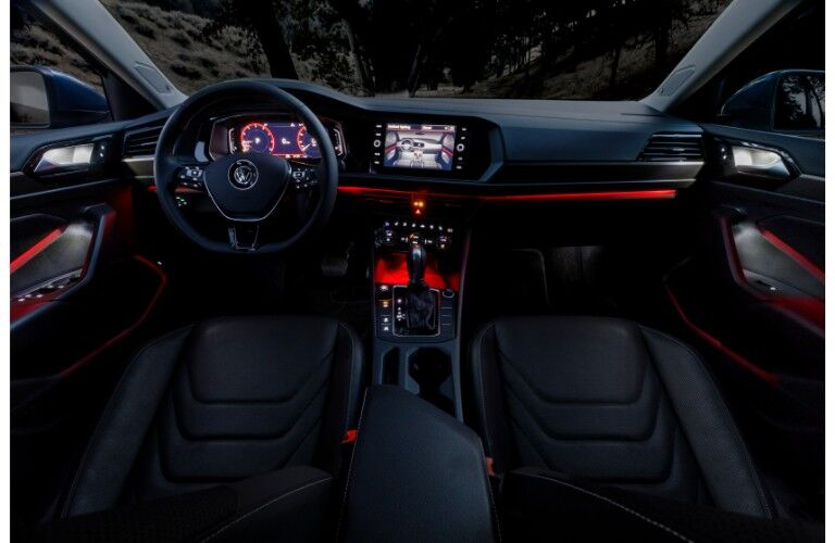 2019 Volkswagen Jetta interior front seat dashboard and steering wheel with ambient red lighting