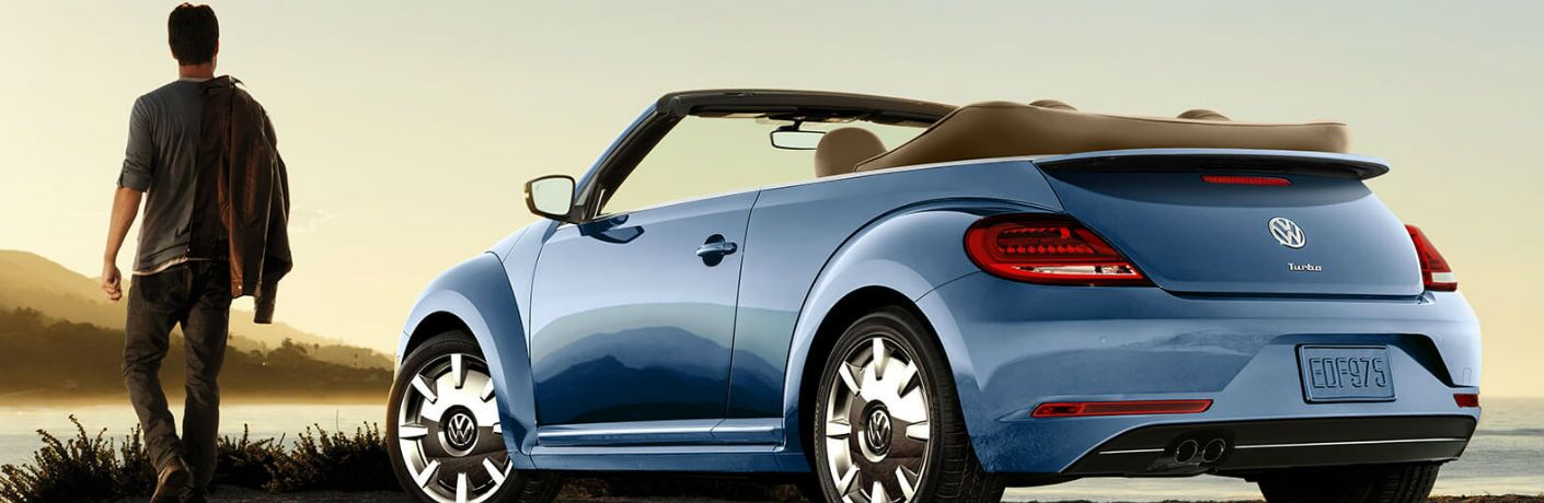 2019 Volkswagen BeetleConvertible parked showing side and rear profile