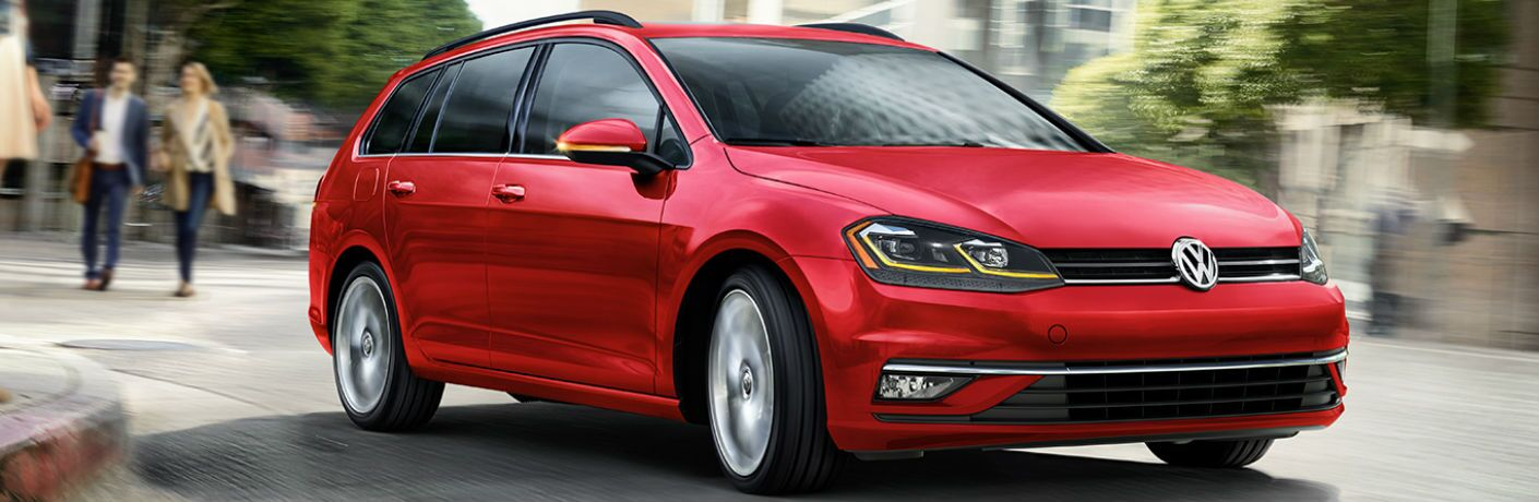 2019 Volkswagen Golf SportWagen driving on a road