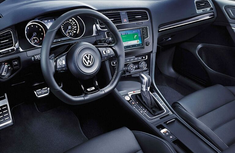 2018 Volkswagen Golf R interior driver's seat angle of dashboard, steering wheel, infotainment screen, and transmission