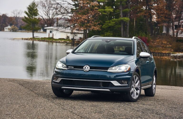 2018 Volkswagen Golf Alltrack exterior shot front end teal parked on a lake beach