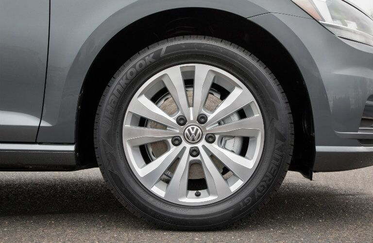 2018 Volkswagen Golf SportWagen exterior shot closeup of a front wheelbase and tire with the VW brand logo
