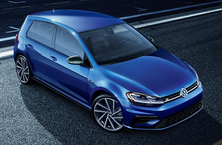2019 Volkswagen Golf R exterior overhead shot with blue paint color parked on a racetrack at night