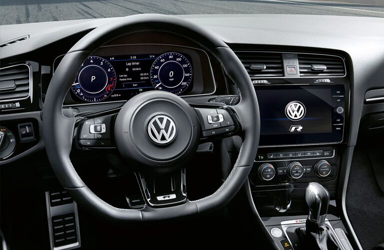 2019 Volkswagen Golf R interior closeup shot of steering wheel, transmission, driver's display, and touchscreen dashboard design