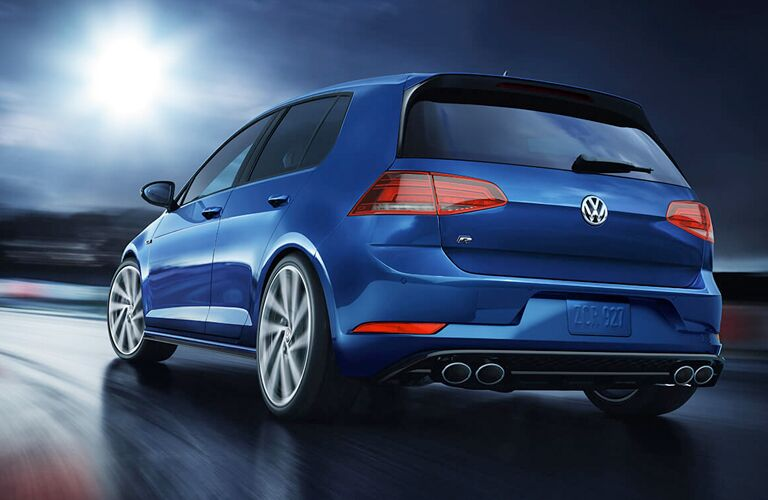 2019 Volkswagen Golf R exterior rear shot with blue paint color showing trunk, bumper, taillights, and quad-tip exhaust system