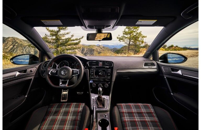 2019 Volkswagen Golf GTI Rabbit Edition interior shot of front plaid seating, steering wheel, and dashboard display