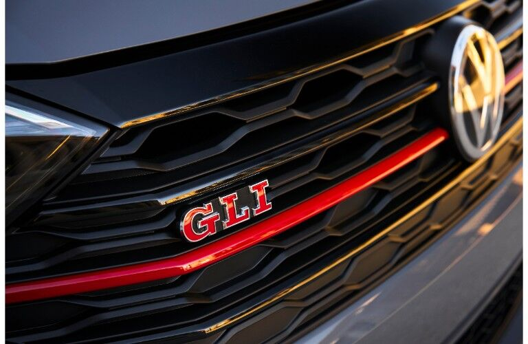 2019 Volkswagen Jetta GLI exterior shot closeup of grille with GLI badge and red strip across it