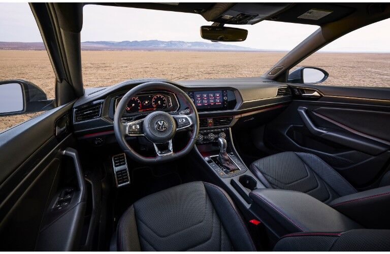 2019 Volkswagen Jetta GLI interior shot of sporty cabin design showing front seating and dashboard