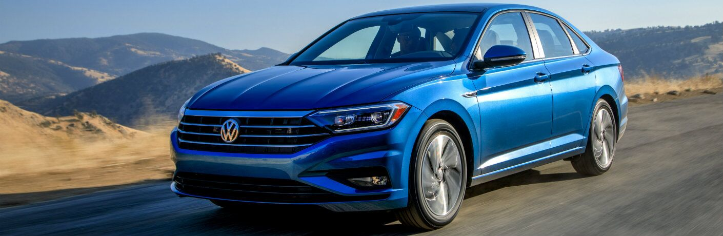 2019 Volkswagen Jetta exterior blue in bright blue sky desert highway