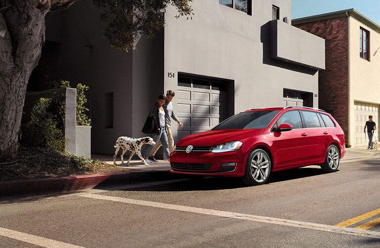2016 volkswagen golf sportwagen in red