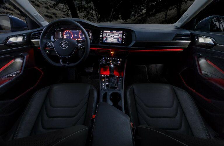 red illuminated front interior of volkswagen jetta
