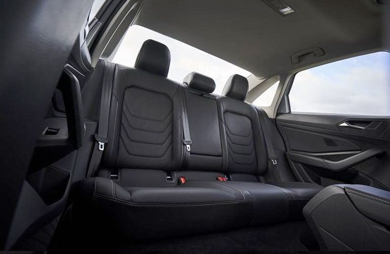 The rear interior view of the passenger seats inside the 2020 Volkswagen Jetta.