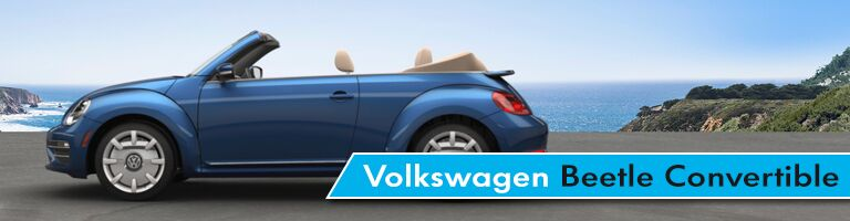 blue vw beetle convertible near beach