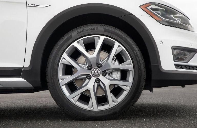 2018 Volkswagen Golf Alltrack exterior closeup of front wheelbase, tire, fascia, and headlights