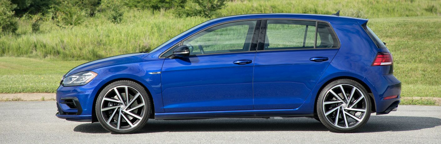 Blue 2018 Volkswagen Golf R Parked next to a Grassy Field