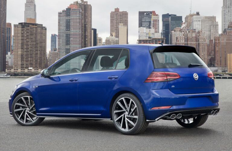 Blue 2018 Volkswagen Golf R with a City Skyline in the Background