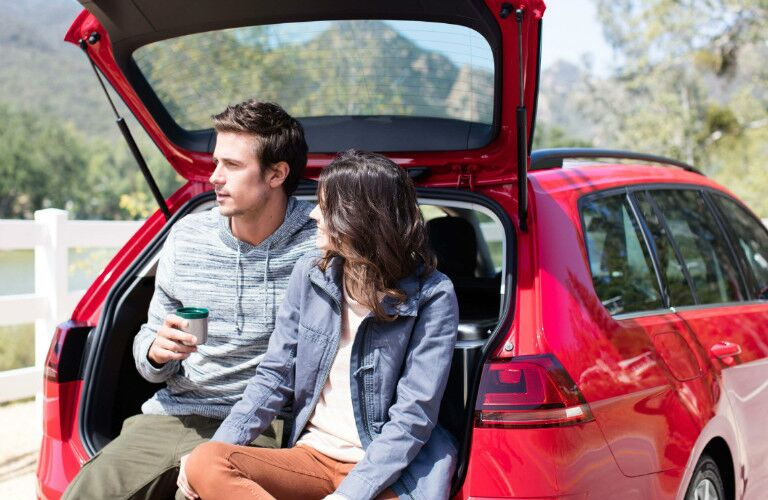 couple enjoying their new golf sportwagen