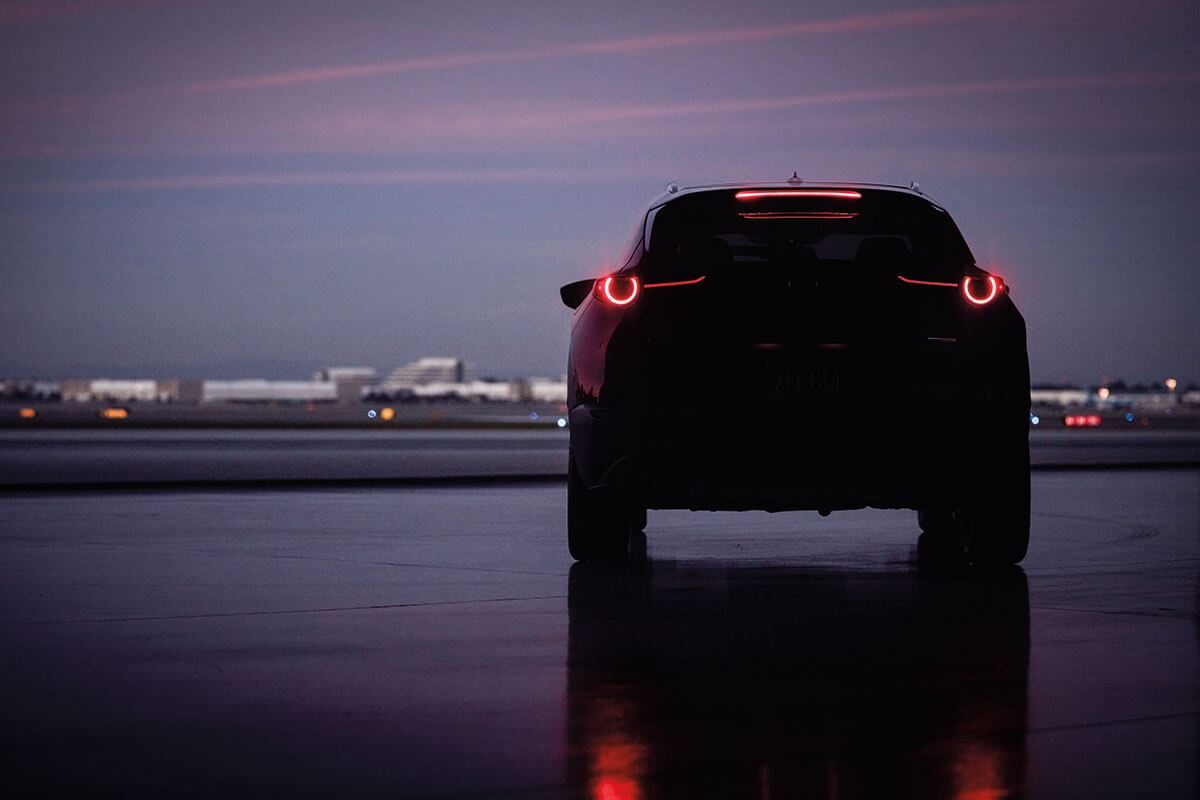The tail-end of a Mazda CX-30 at dusk near Salinas, CA